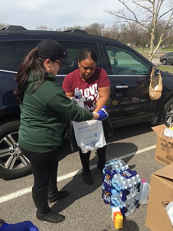 Community member picks up bottled water
