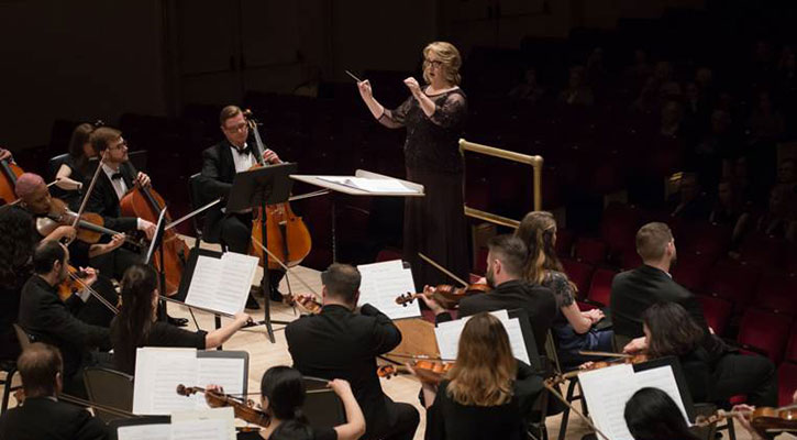 Dr. Lisa A. Billingham leads the George Mason University Chorale with the New England Symphonic Ensemble at Carnegie Hall.