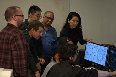 Liling Huang works with students on their microgrid projet