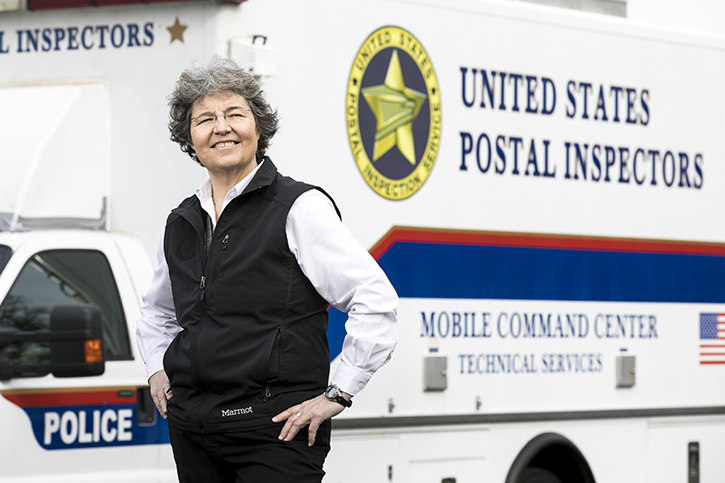 Stephanie Smith in front of a US Postal Inspectors truck