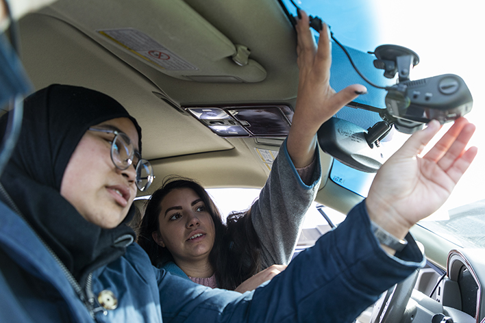 graduate students in car installing air pollution monitor