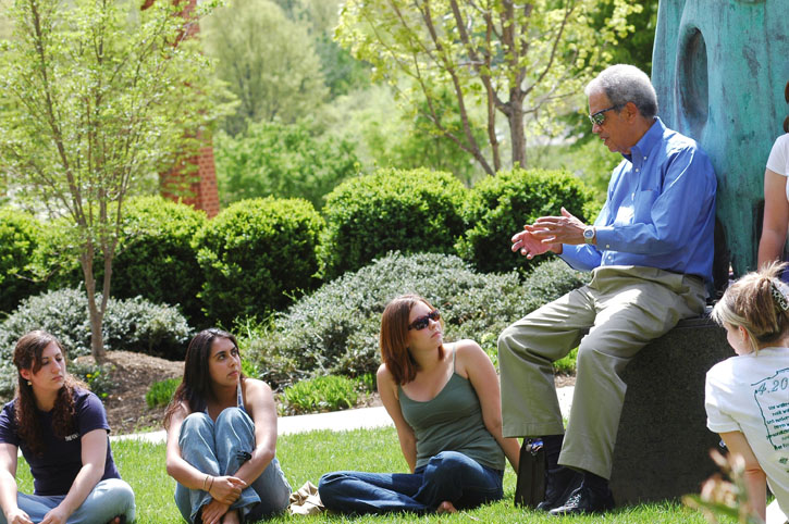 Roger Wilkins talks with students outside on Mason's Fairfax Campus in 2006.
